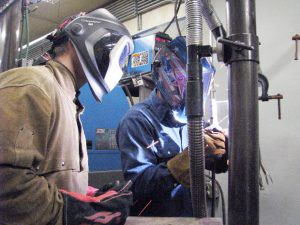 M State Workforce Development Solutions welding instructor Josh Heibel (right) demonstrates welding techniques with Moorhead High School instructor Jeff Schneider.